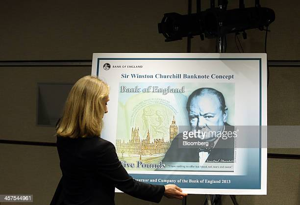 Victoria Cleland head of notes division of the Bank of England arranges a concept design for the new Bank of England five pound polymer banknote...