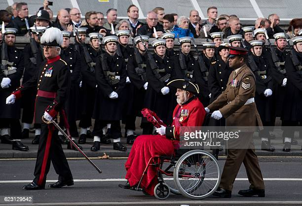 Victoria Cross holders Bill Speakman and Johnson Beharry parade along Whitehall after the Remembrance Sunday ceremony at the Cenotaph in London on...