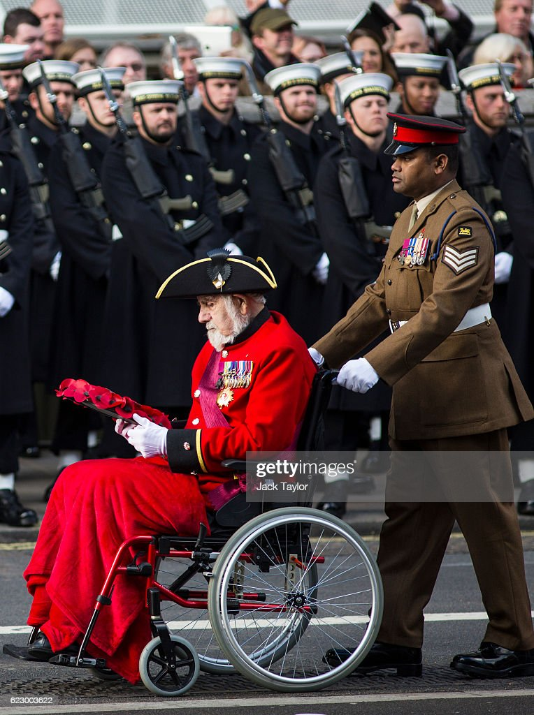 Victoria Cross holders Bill Speakman, (L) and Johnson Beharry (R) parade during the annual Remembrance Sunday Service at the Cenotaph on Whitehall on November 13, 2016 in London, England. The Queen, senior politicians, including the British Prime Minister and representatives from the armed forces pay tribute to those who have suffered or died at war.