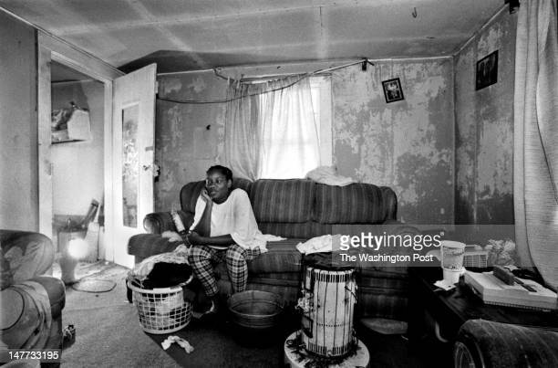 FILE Victoria Cummings sits in the living room her home in Bayview Virginia on May 9 1998 Her rent is $45 per month and she like to move away but she...