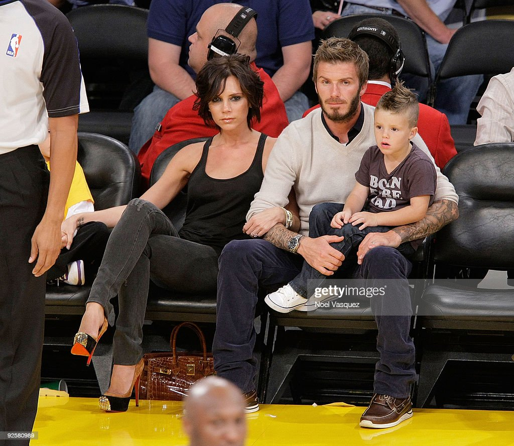 Victoria, David and Romeo Beckham attend the Los Angeles Lakers vs Dallas Mavericks game on October 30, 2009 in Los Angeles, California.
