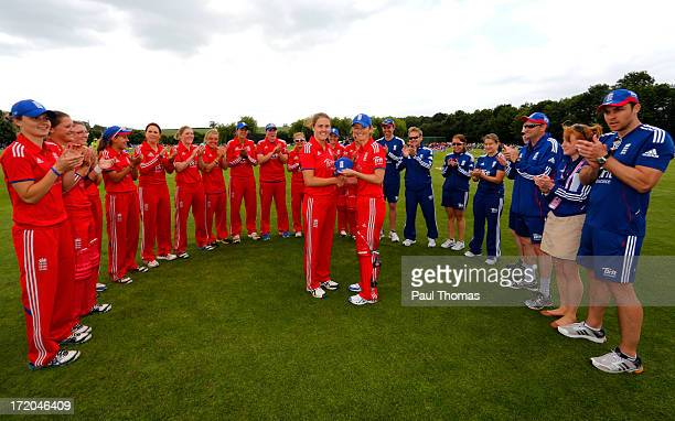 Victoria Edwards of England presents a cap to team mate Natalie Sciver before the 1st NatWest Women's One Day International match between England and...