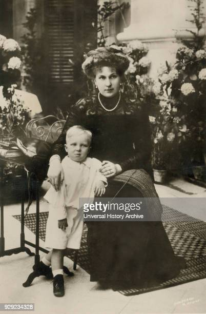 Victoria Eugenie of Battenberg Queen Victoria of Spain through her Marriage to King Alfonso XIII with her son Alfonso Prince of Asturia Portrait 1909