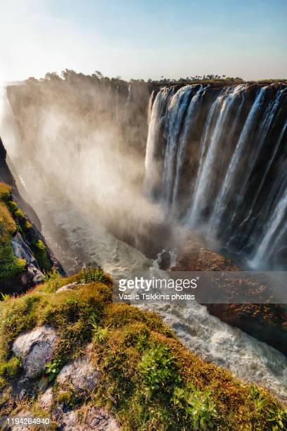 victoria falls against the sun - victoria falls stock pictures, royalty-free photos & images