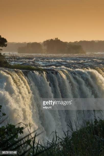 Victoria Falls bij zonsopgang oranje