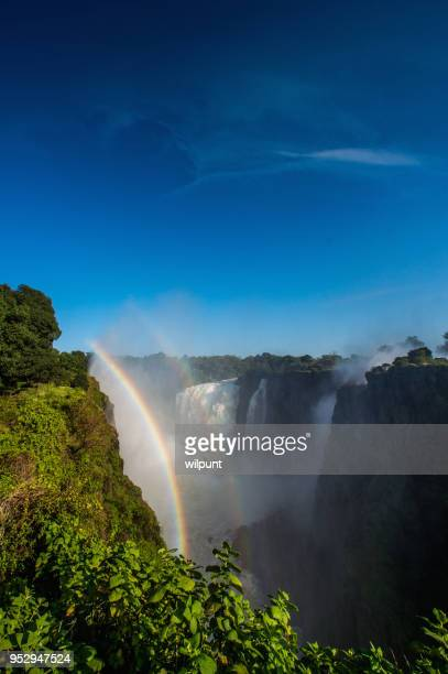 victoria falls double rainbow vertical - victoria falls stock pictures, royalty-free photos & images