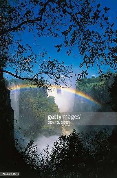 Victoria Falls on the Zambezi River with rainbow Zimbabwe