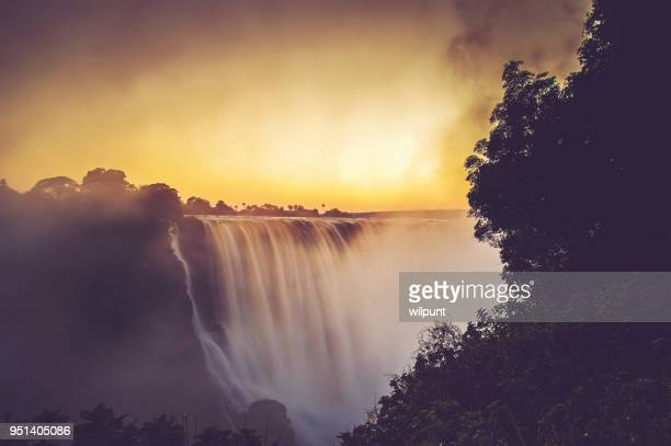 victoria falls sunrise long exposure - zimbabwe stock pictures, royalty-free photos & images