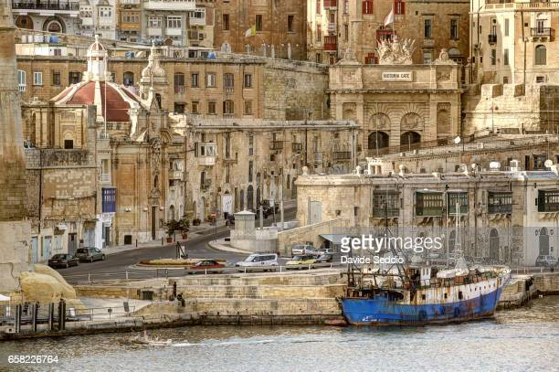Valletta, Malta - October 2016: Victoria Gate and Valletta seaside viewed from Senglea.