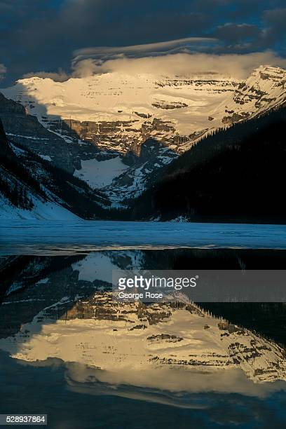 Victoria Glacier perched above Lake Louise is bathed in bright early morning sunlight on April 27 2016 at Lake Louise Alberta Canada Banff is...