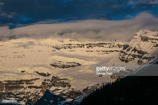 Victoria Glacier perched above Lake Louise is bathed in bright sunlight on April 27 2016 at Lake Louise Alberta Canada Banff is Canada's oldest...