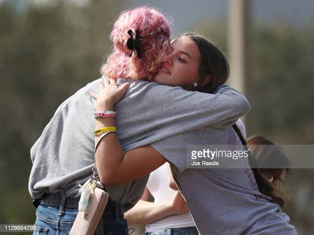 Victoria Gonzalez hugs Allison Torres both of whom are students at Marjory Stoneman Douglas High School as they remember those lost during a mass...