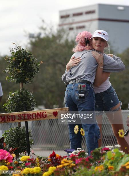 Victoria Gonzalez hugs Mallory Muller both of whom are students at Marjory Stoneman Douglas High School as they remember those lost during a mass...