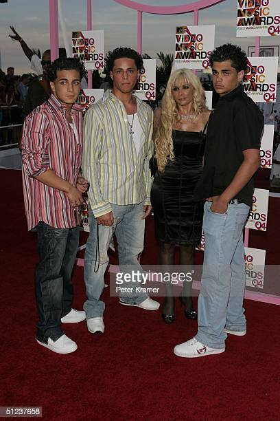 Victoria Gotti and her family arrives at the 2004 MTV Video Music Awards at the American Airlines Arena August 29 2004 in Miami Florida