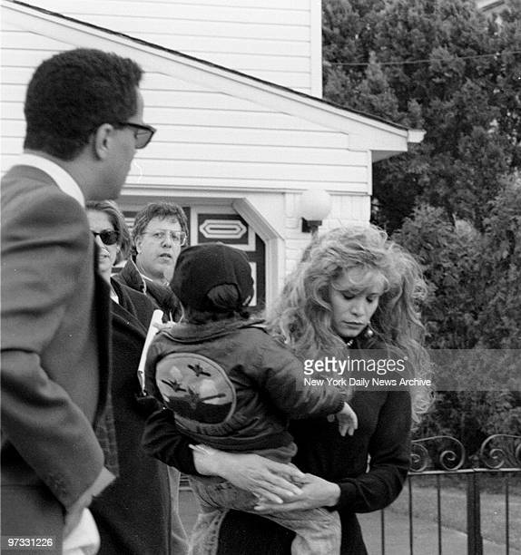 Victoria Gotti daughter of John Gotti leaves her father's house in Howard Beach Queens carrying her son