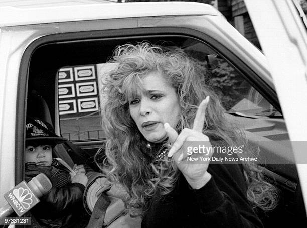 Victoria Gotti daughter of John Gotti leaves her father's house in Howard Beach Queens with her son