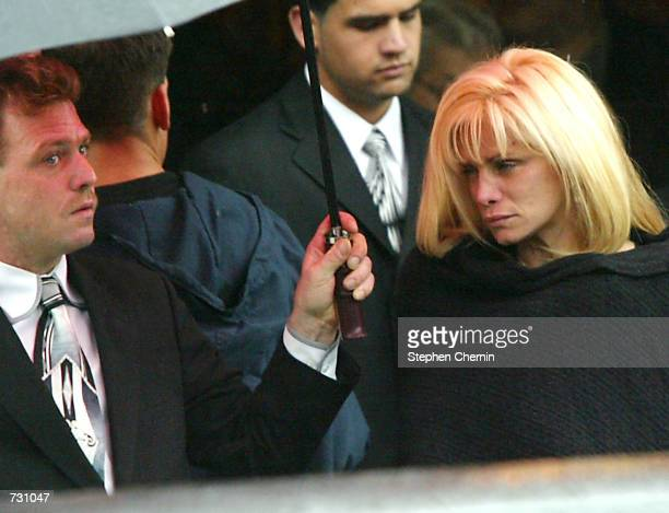 Victoria Gotti daughter of mobster John Gotti leaves the Papavero funeral home after a wake held for John Gotti June 14 2002 in the Queens borough of...