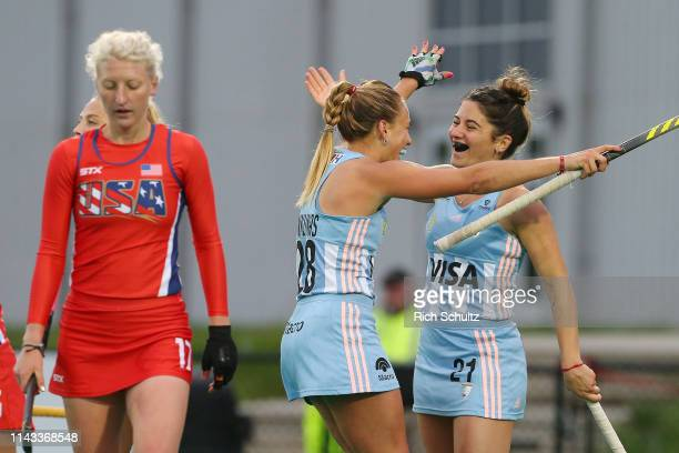 Victoria Granatto of Argentina celebrates her goal with Julieta Jankunas as Anna Dessoye of the United States walks away during the Women's FIH Field...