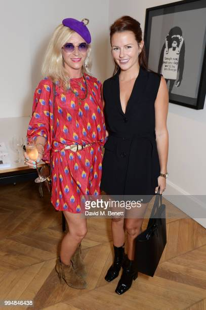 Victoria Grant and Claudia Lambeth attend the Bansky 'Greatest Hits 20022008' exhibition VIP preview at Lazinc on July 9 2018 in London England
