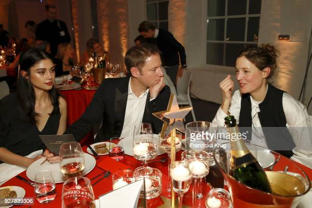 Victoria Guptara Florian Gallenberger and Vicky Krieps during the Moet Academy Night on March 4 2018 in Berlin Germany