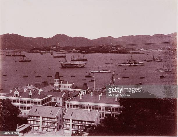 Victoria Harbor in Hong Kong during the 1880s The harbor is crowded with anchored sailing ships steampowered ships and rowboats