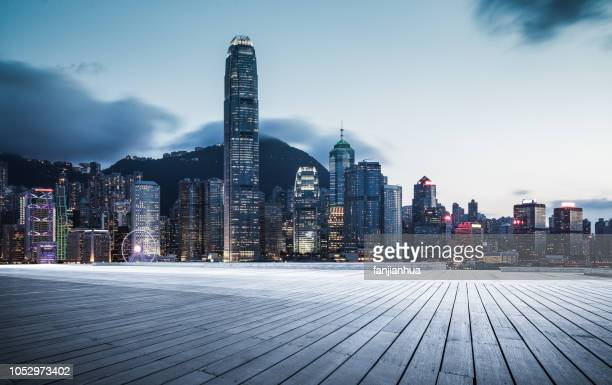 victoria harbor with a plank - two international finance center stock pictures, royalty-free photos & images