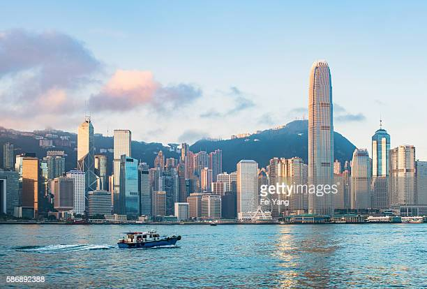 victoria harbour at morning, hong kong - hong kong stock pictures, royalty-free photos & images