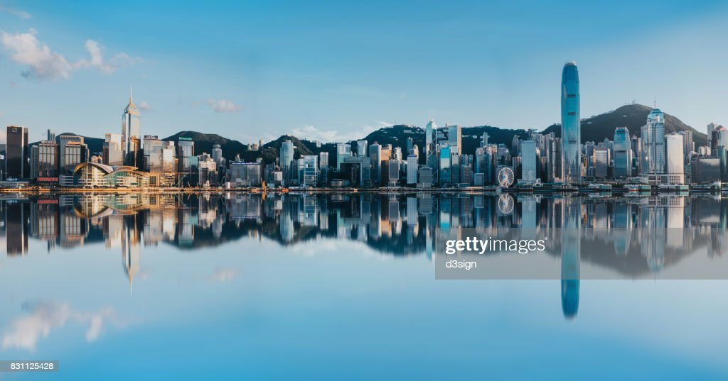 Victoria Harbour with panoramic view of Hong Kong city skyline : Stock Photo