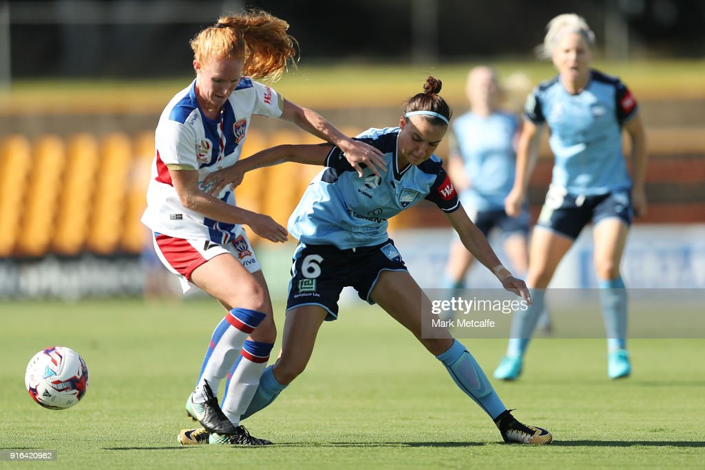 Victoria Huster of Newcastle Jets and Chloe Logarzo of Sydney FC compete for the ball during the W-League semi final match between Sydney FC and the Newcastle Jets at Leichhardt Oval on February 10, 2018 in Sydney, Australia.