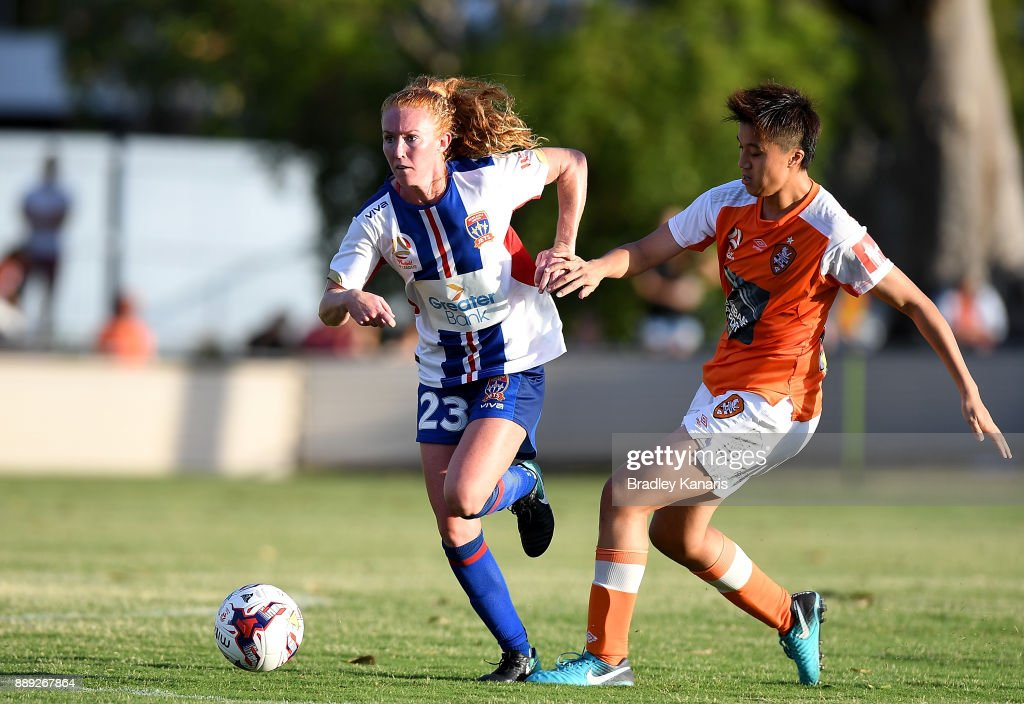 Victoria Huster of the Jets breaks away from the defence of Wai Ki Cheung of the Roar during the round seven W-League match between the Brisbane Roar and the Newcastle jets at AJ Kelly Reserve on December 10, 2017 in Brisbane, Australia.