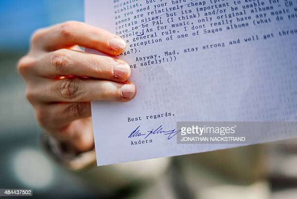 Victoria in her mid20s shows a letter sent to her and signed by Anders Breivik on July 31 2015 in Stockholm Victoria claims Anders Behring Breivik is...