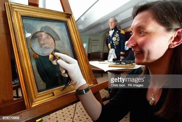 Victoria Ingles Curatorial Project Officer of the Royal Navy Museum in Portsmouth inspects a portrait of Admiral Lord Nelson in the Great Cabin...
