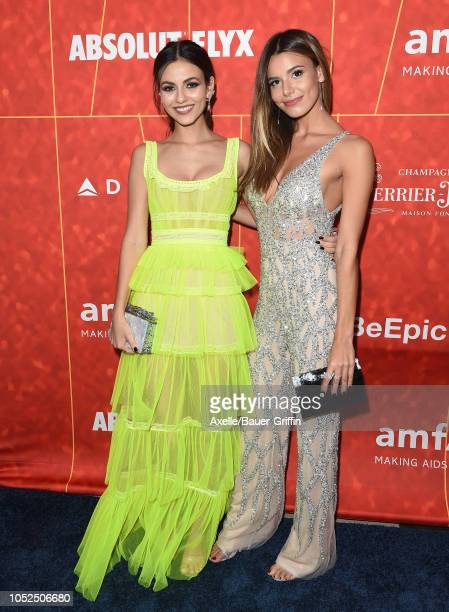 Victoria Justice and sister Madison Reed attend the amfAR Gala Los Angeles 2018 at Wallis Annenberg Center for the Performing Arts on October 18 2018...
