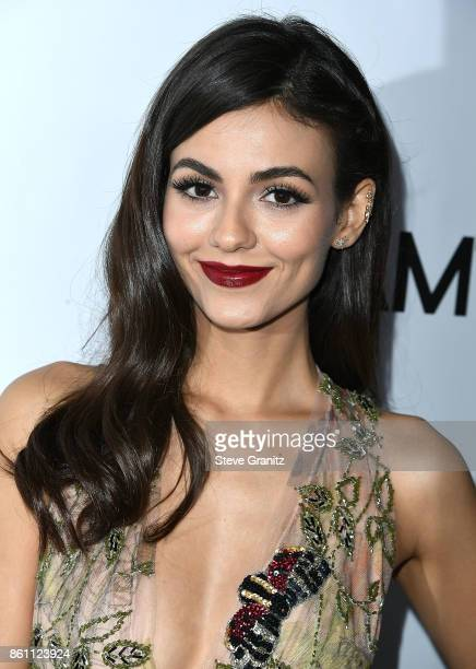 Victoria Justice arrives at the amfAR Los Angeles 2017 at Ron Burkle's Green Acres Estate on October 13 2017 in Beverly Hills Californi
