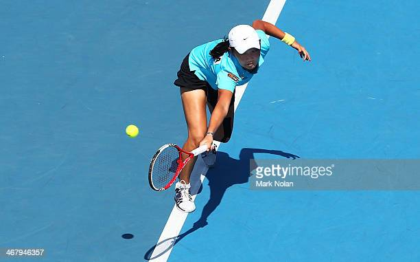 Victoria Kan of Russia plays a backhand in her singles match against Samantha Stosur of Australia during the Fed Cup tie between Australia and Russia...
