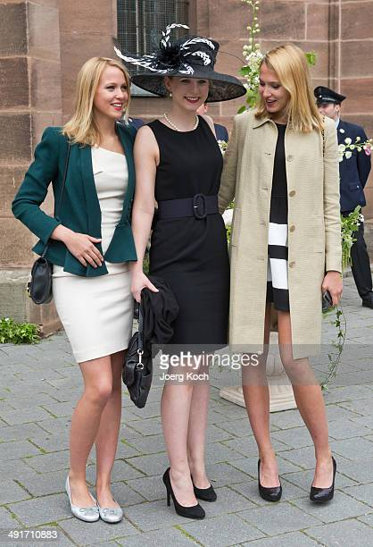 Victoria Katharina and Sarah von FaberCastell arrive at MartinLutherChurch on May 17 2014 in Stein near Nuremberg Germany