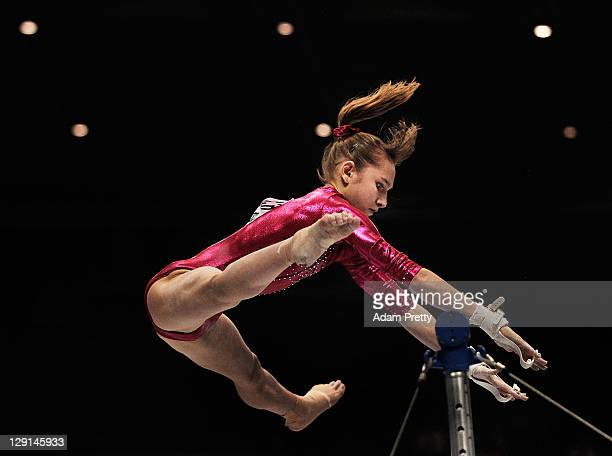 Victoria Komova of Russia competes on the Uneven Bars aparatus of the Women's All Around Final during day seven of the Artistic Gymnastics World...