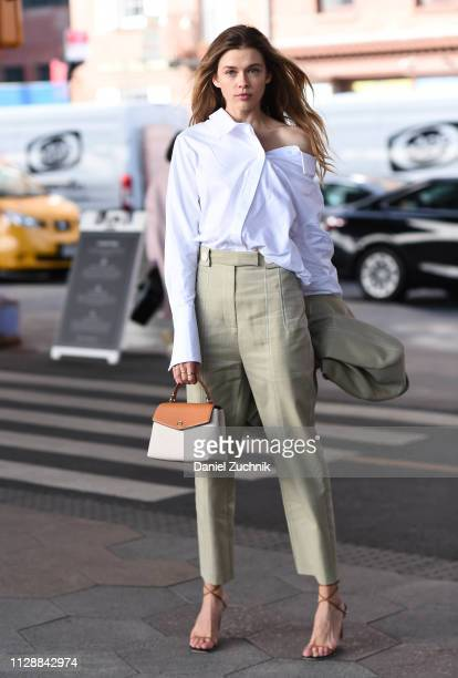 Victoria Lee is seen wearing a white shirt brown pants and coat with a Tory Burch bag outside the Tory Burch show during New York Fashion Week...