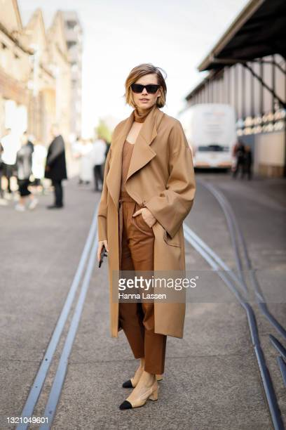 Victoria Lee wearing beige Oroton trench wool coat and Chanel shoes at Afterpay Australian Fashion Week 2021 on June 01, 2021 in Sydney, Australia.