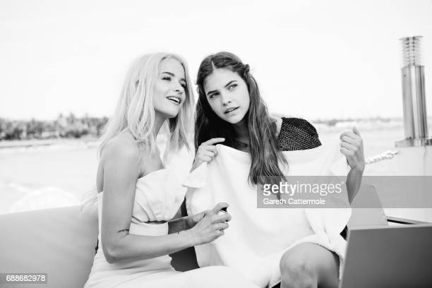 Victoria Magrath and Barbara Palvin are photographed at the L'Oreal paris beach on May 24 2017 in Cannes France