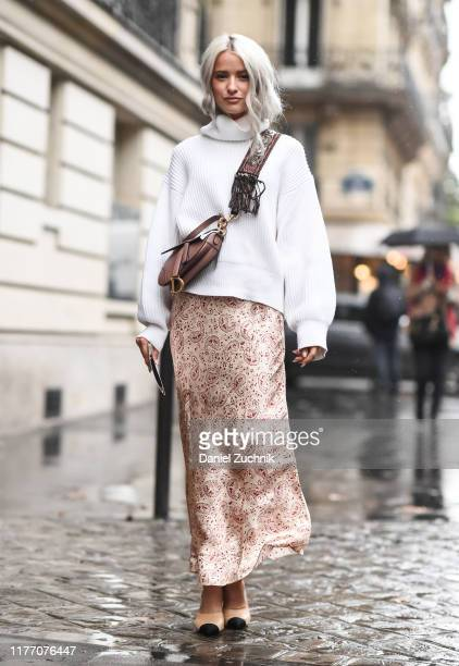 Victoria Magrath is seen wearing a cream sweater pink skirt and brown purse outside the Lanvin show during Paris Fashion Week SS20 on September 25...