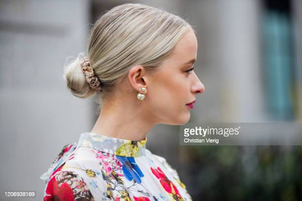 Victoria Magrath is seen wearing dress with floral outside Erdem during London Fashion Week February 2020 on February 17, 2020 in London, England.