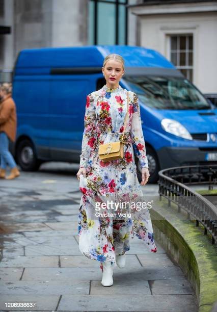Victoria Magrath is seen wearing JW Anderson bag, dress with floral print outside Erdem during London Fashion Week February 2020 on February 17, 2020...