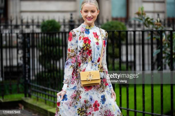 Victoria Magrath is seen wearing JW Anderson bag, dress with floral outside Erdem during London Fashion Week February 2020 on February 17, 2020 in...