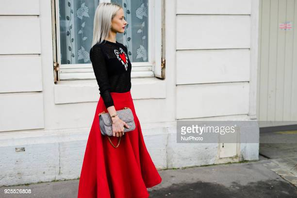 Victoria Magrath is seen wearing red skirt a Dior sweater and a Dior Bag in the streets of Paris before the Dior show during Paris Fashion Week...