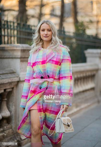 Victoria Magrath seen wearing colorful striped coat , pastel boots, bag outside Viktor & Rolf during Paris Fashion Week - Haute Couture Spring/Summer...