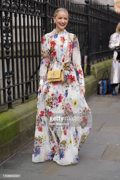 Victoria Magrath wearing floral dress with yellow purse attends Erdem at National Portrait Gallery during London Fashion Week February 2020 on...
