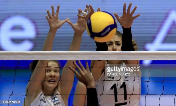 Victoria Mayer and Julieta Lazcano of Argentina block a ball from Johenlis Belisario of Venezuela during their women's Tokyo 2020 Volleyball...