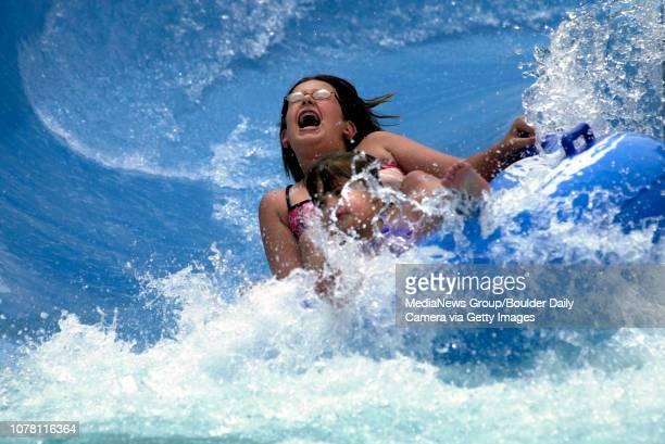 Victoria Melendez and Shalene Cruz splash at the bottom of the big blus water slide at The Bay on Saturday