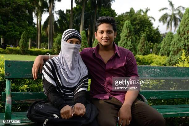 Victoria Memorial in Kolkata Young lovers in the gardens of Victoria Memorial in Kolkata during the monsoon on June 20 2016 in Kolkata India